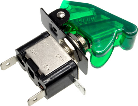 Photo of the front of a green illuminated missile switch.