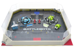 Photo of a bottlebots arena pro kit that includes two robots, two remotes and an arena.