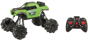 Photo of a green 1:16 remote controlled rock crawler with sideways drift.