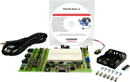 Photo of a Picaxe Ultimate Experimenter Board with a USB cable.