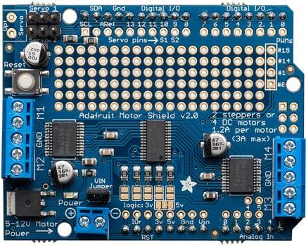 Photo of an Adafruit servo motor/stepper shield for Arduino.