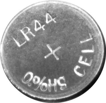 Photo of a LR44 A76 alkaline button cell battery.