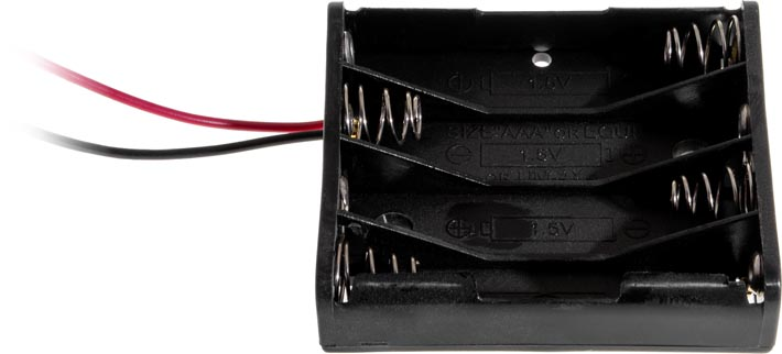 Photo of a battery holder that holds four AAA battery cells, taken from the side.