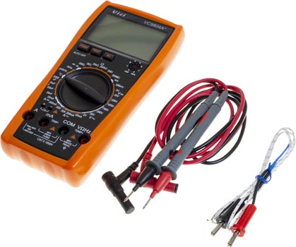 Photo of a digital LCD multimeter/voltmeter/ammeter that measures/tests AC DC OHM volt current, plus the included cables.
